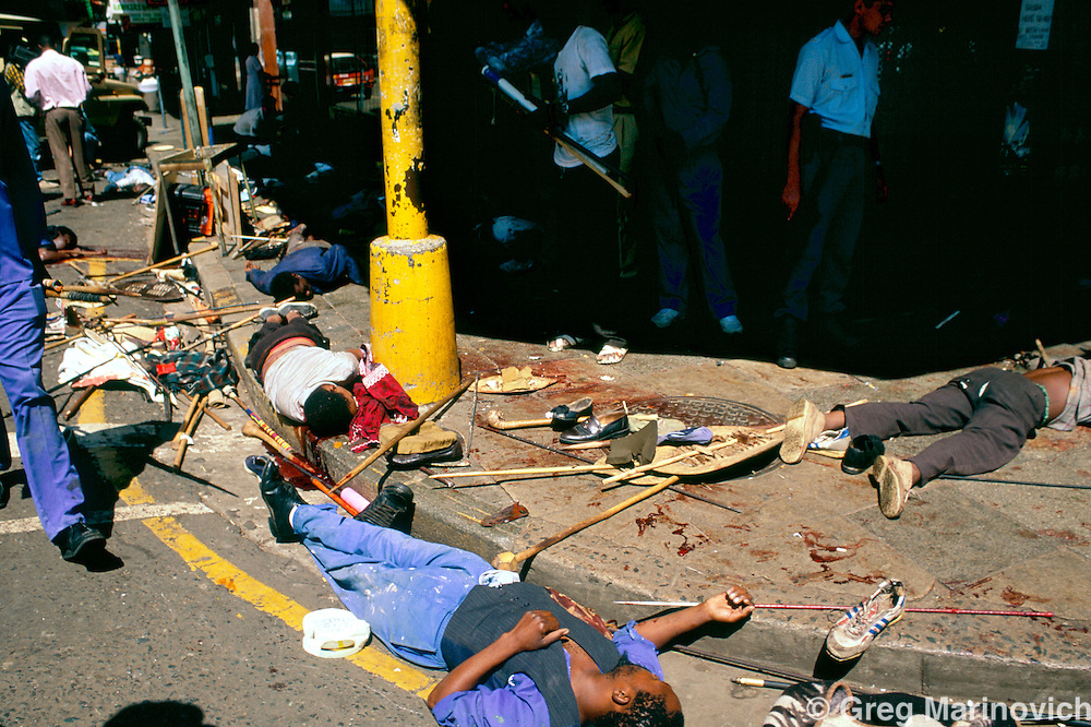 Johannesburg, South Africa, 1994. African National Congress guards opened fire on Inkatha Freedom Party marchers when they approached the ANC headquarters of Shellhouse, Johannesburg 1994. Many IFP supporters killed and wounded. Others were shot from the rooftops by persons unknown at the nearby Library Gardens. Johannesburg, South Africa