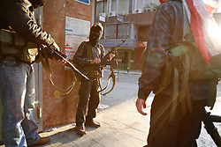 Shia Amal militants carrying Kalishnakovs and rocket-propelled grenade launchers trade shots with Sunni Future militants across the Cornish al-Mezraa boulevard in Beirut on 8 May 2008. Political deadlock turned into the deadliest street battles since the country's 15-year civil war.