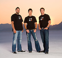 Three guys on the salt flats at dusk
