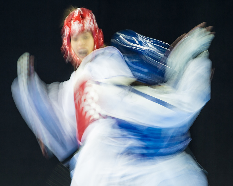 Celina Proffen (L) of Argentina  takes on Carolina Carstens of Panama during their 1/8 round contest in the -57kg weight class of Taekwondo at the 2015 Pan American Games in Toronto, Canada, July 20,  2015.  AFP PHOTO/GEOFF ROBINS