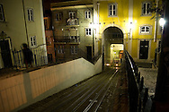 Railroads of the Bica's elevator, which connects the lower part of the old neighborhood to the upper one. There are several elevators in the old neighborhoods of Lisbon, which help people to go through the steep slopes of the city's hills. They constitute also a touristic attraction.