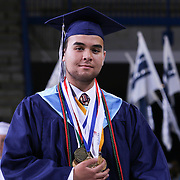 Delcastle Salutatorian William Esteves participate in a Academic Procession prior to Delcastle Forty-Sixth commencement exercises Tuesday, May 26, 2015, at The Bob Carpenter Sports Convocation Center in Newark, Delaware