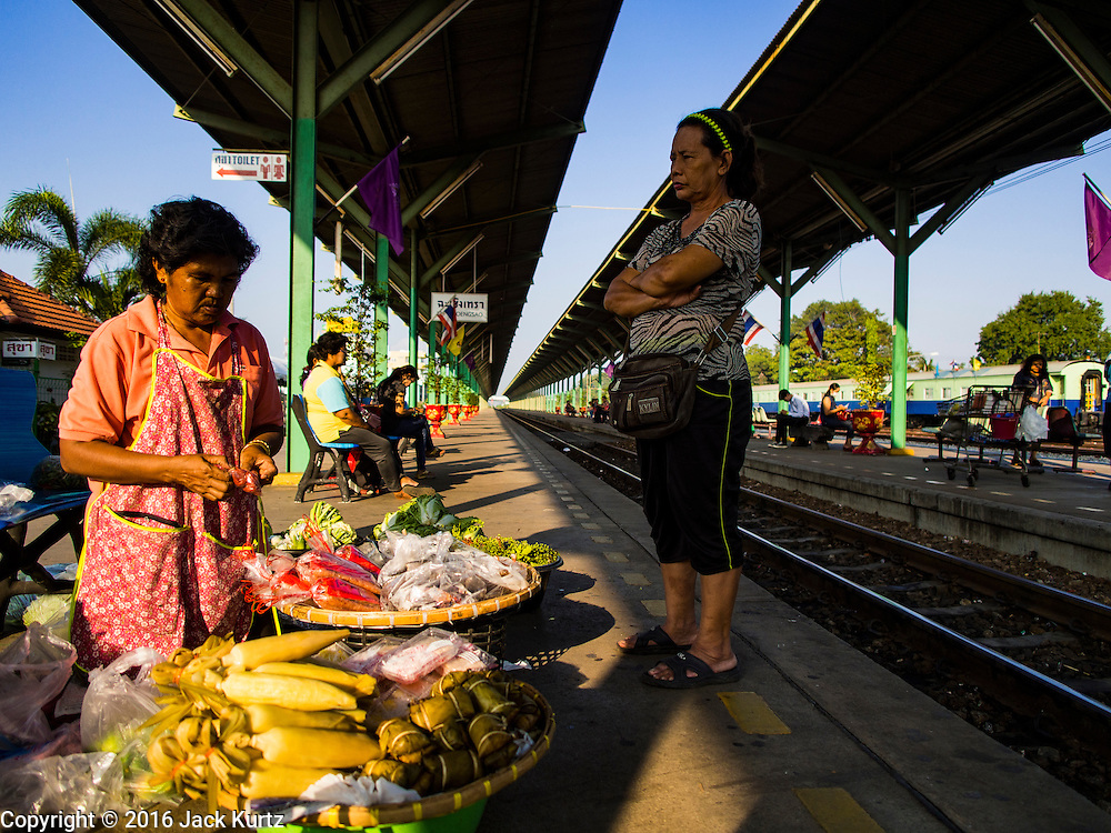 14 JANUARY 2016 - CHACHOENGSAO, CHACHOENGSAO, THAILAND: A woman sells fresh produce on the platform in Chachoengsao Train Station.         PHOTO BY JACK KURTZ