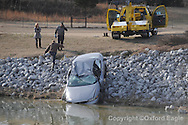 A car is pulled from the lake at Wellsgate following a wreck in Oxford, Miss. on Thursday, February 25, 2010.