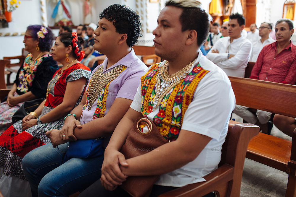 Angelo Martinez Linares, 24, during a mass in Juchit&aacute;n, Mexico.<br /> <br /> In Juchit&aacute;n in the southern state of Oaxaca, Mexico, the world is not divided simply into gay and straight, the locals make room for a third category, whom they call &ldquo;muxes&rdquo;.<br /> <br /> Muxes are men who consider themselves women and live in a socially sanctioned netherworld between the two genders. &ldquo;Muxe&rdquo; is a Zapotec word derived from the Spanish &ldquo;mujer&rdquo; or woman; it is reserved for males who, from boyhood, have felt themselves drawn to living as a woman, anticipating roles set out for them by the community.<br /> <br /> They are considered hard workers that will forever stay by their mothers side, taking care for their families operating as mothers without children of their own.<br /> <br /> Not all muxes express they identities the same way. Some dress as women and take hormones to change their bodies. Others favor male clothes. What they share is that the community accepts them.