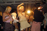 Models dancing at the Rene Bardot fashion show in Los Angeles, CA 10/29/2003..