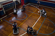 The Power Soccer Rio de Janeiro Clube team performs an offensive move during a training session.