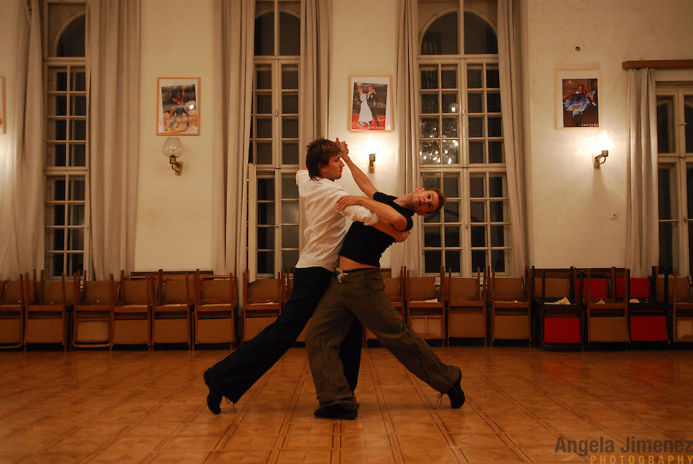 """World Champion same-sex ballroom dancers Robert Tristan Szelei, right, and Gergely Darabos practice their routines at a lesson session at Leovey Klara High School in Budapest, Hungary on October 18, 2006, in preparation for the 2nd annual World Championship Same-Sex Ballroom Dancing competition, which was held in their hometown on October 21, 2006. ..This lesson session, taught by a former Hungarian opposite-sex champion, is one of the few spaces in Budapest which allows same-sex couples to train. Szelei and Darabos negotiated for the session to be open to them and other same-sex dancers who came to town for the competition. ..The dance couple, known as the """"Black Swans,"""" are the reigning world champions in men?s Latin same-sex ballroom dancing. They have been training and preparing to host the 2nd annual World Championship and the Csardas Cup, the first-ever Eastern European same-sex ballroom competition, both held at the Korcsarnok arena.  This is the pinnacle event of the blossoming same-sex ballroom scene...Szelei and Darabos went on to win the men?s Standard division and finished fourth in the Latin division. ..The event was organized by the US-based World Federation of Same-Sex Dancing, which hosted the first World Championship Same-Sex championships in 2005 in Sacramento, California. The Black Swans did a large amount of the coordination and planning in Budapest, a city that had never seen an event of this kind. When government funding fell through, they secured funding from patron Desire (accent on the ?e?) Dubounet, owner of the local Club Bohemian Alibi drag club. ..The World Championship events are newly recognized, but same-sex dancers have been competing on a national and international circuit for a number of years, especially in Europe, including at the Eurogames, the Gay Games, the London Pink Jukebox Trophy and the Berlin Open, among others. Countries including the United States, the Netherlands, Germany and, now, Hungary, hold their own national sam"""