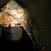 """Ms. Sana'a"" by Amira Al Sharif.  Yemeni woman in traditional clothing in Sana'a, Yemen,"