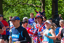 London, May 25th 2014. A patriotic runner sets off on the Bupa London 10,000 run in St Jame's Park.