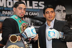 Aug 30, 2012; Brooklyn, NY, USA; WBA/WBC Super Lightweight Champion Danny Garcia (l) and Erik Morales (r) pose at the press conference at New York Marriott at the Brooklyn Bridge. The two will meet on October 20, 2012 at the Barclay's Center in Brooklyn, NY.