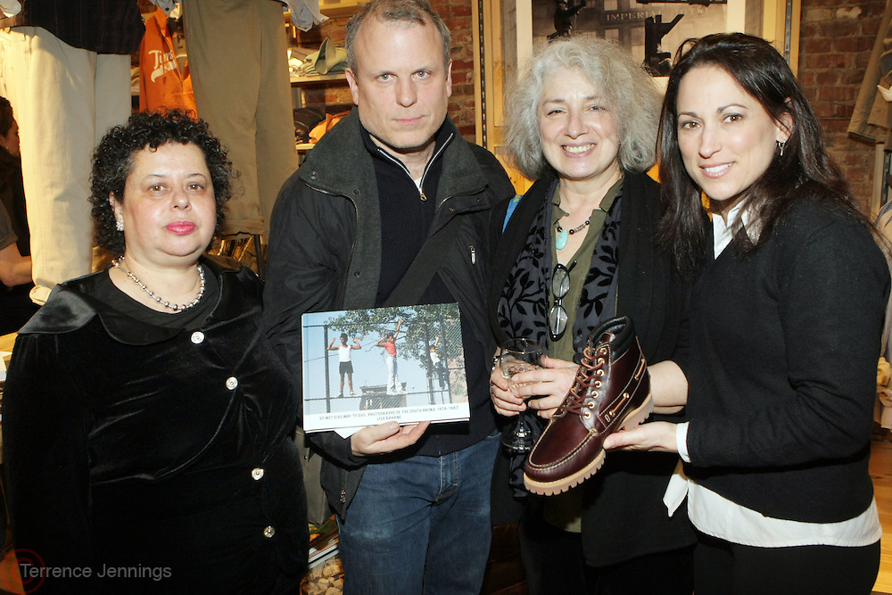 l to r: Arlene Gottfried, Daniel Power, Lisa Kahane, and Jenny Billings at The Timberland New Store Opening in Soho featuring a Powerhouse Books Exhibition, ' Nature of a City ' featuring NY based Photographers Janette Beckman, Vivian Cherry, Martha Cooper, Arlene Gottfried, Lisa Kahane, Maripol, Ricky Powell and Jamel Shabazz held at The Timberland Store in New York City on March 27, 2009..The exhibit, entitled Nature of a City, features images from the powerHouse archives that capture the energy and vitality of a city that - like Timberland - is constantly evolving, creating and defying trends. For the exhibit, powerHouse and Timberland selected photos from New York-based photographers Janette Beckman, Vivian Cherry, Martha Cooper, Arlene Gottfried, Lisa Kahane, Maripol, Ricky Powell and Jamel Shabazz.