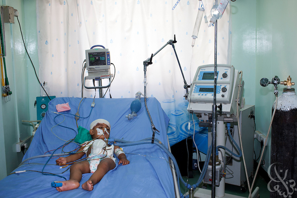 A critically wounded Iraqi girl remains in the intensive care unit at the Khadamiyah hospital following a fatal crash that claimed both her parents, and her only brother in Baghdad August 25, 2010. After seven years of war, many Iraqi hospitals continue to be overcrowded, in a state of disrepair and stocked with old or outdated medical equipment.   .