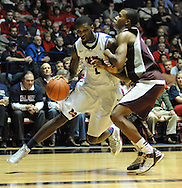 "Mississippi's Terrance Henry (1) is fould by Mississippi State's Rodney Hood (4) at the C.M. ""Tad"" Smith Coliseum in Oxford, Miss. on Wednesday, January 18, 2012. Mississippi won 75-68. (AP Photo/Oxford Eagle, Bruce Newman)."