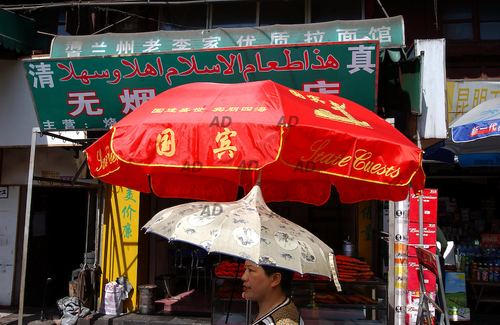 A woman with strange umbrella in the muslim district.