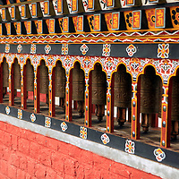 Asia, Bhutan, Thimpu. Prayer Wheels of the cnetral square in Thimpu.