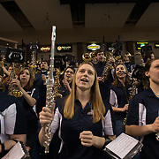The band cheers on the women's basketball team in their win againt Mary's at McCarthey Athletic Center in February. (Photo by Rajah Bose)