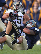 Linebacker Manti Te'o (5) brings down Purdue Boilermakers running back Dan Dierking (25).