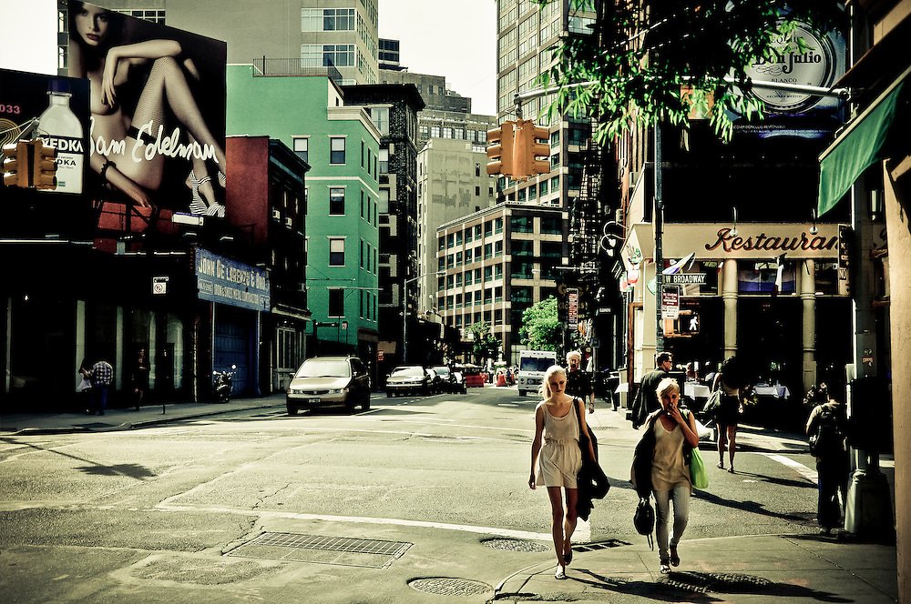 Two girls walking at the corner of South broadway Avenue and Grand street, Manhattan, New York, 2010.