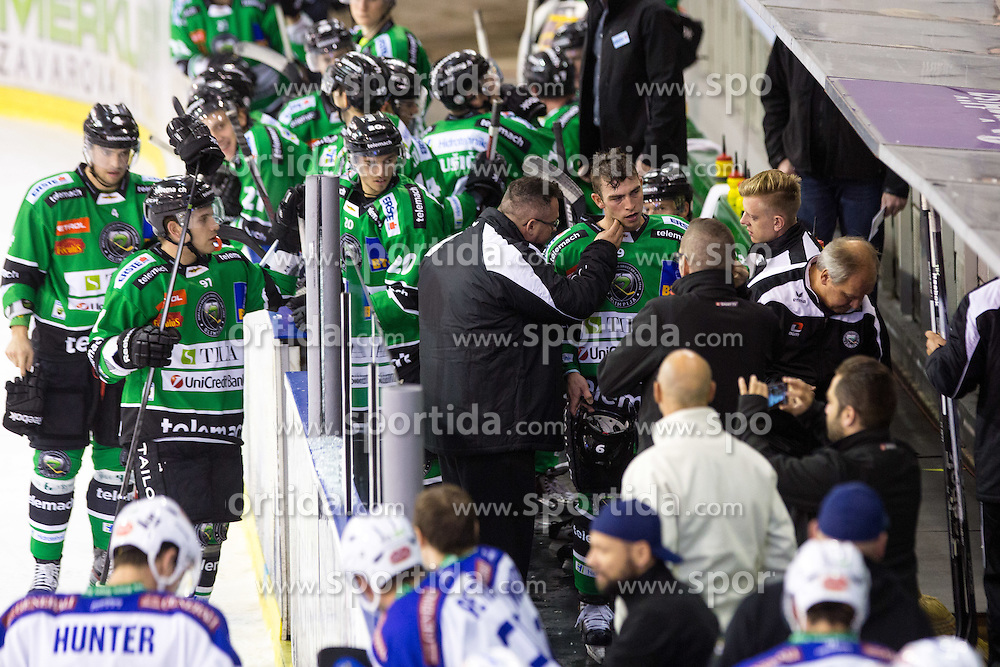 26.09.2014, Hala Tivoli, Ljubljana, SLO, EBEL, HDD Telemach Olimpija Ljubljana vs EC VSV, 5. Runde, in picture Hunter Bishop (HDD Telemach Olimpija, #9) receiving medical assistance after hard hit in the board during the Erste Bank Icehockey League 3. Round between HDD Telemach Olimpija Ljubljana and EC VSV at the Hala Tivoli, Ljubljana, Slovenia on 2014/09/26. Photo by Matic Klansek Velej / Sportida
