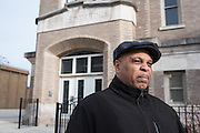 Dwayne Truss of the Austin Community Action Council stands outside Key Elementary, closed since 2013.