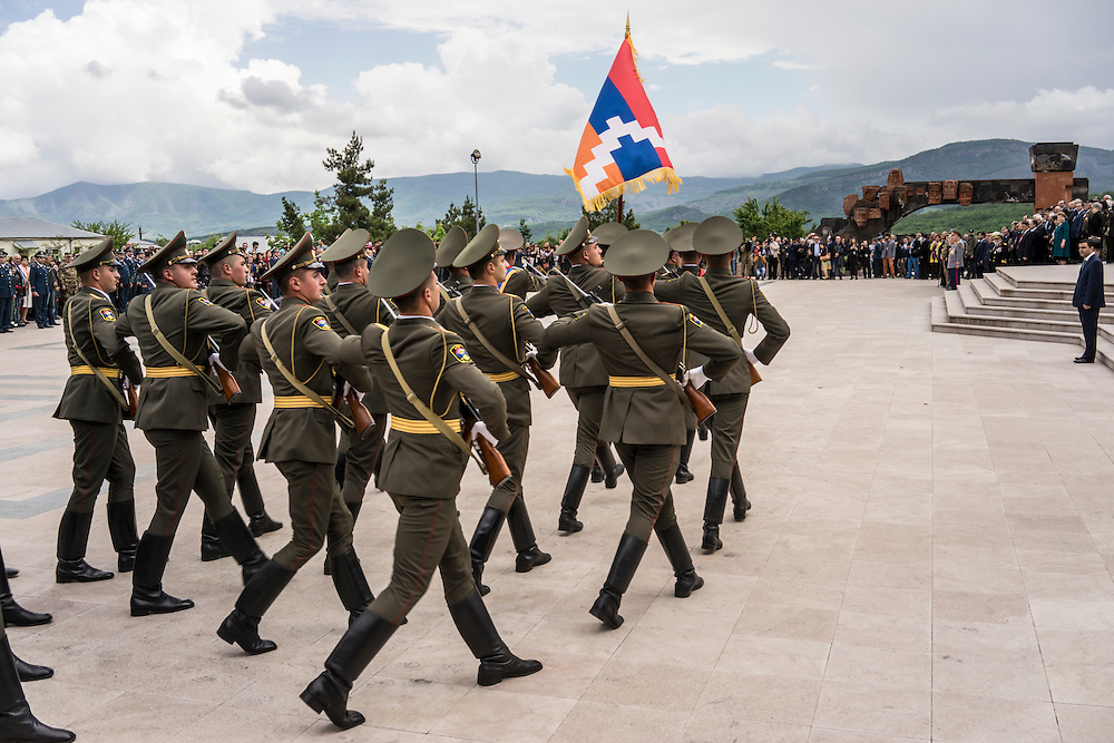 Soldiers from the Nagorno-Karabakh military participate in a ceremony commemorating both the victory over Nazi Germany in the Second World War as well as the fall of the strategic town of Shushi to Armenian forces on Monday, May 9, 2016 in Stepanakert, Nagorno-Karabakh.