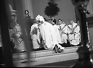 Episcopal Ordination Of Desmond Connell. (R74).1988..06.03.1988..03.06.1988..6th March 1988..Following the death of Archbishop Kevin McNamara in April '87, Pope John Paul II surprisingly nominated Desmond Connell for the position of Archbishop of Dublin. The ordination of Dr Connell took place at the Pro-Cathedral in Dublin...Image shows Dr Connell donning the Mitre of Office as he is conferred as Archbishop of Dublin.