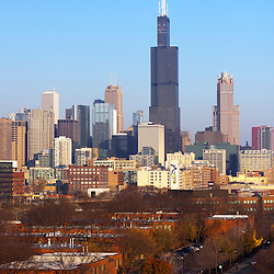 Chicago, IL Fall Skyline view including the Willis/Sears Tower rising high over the surrounding city landscape.