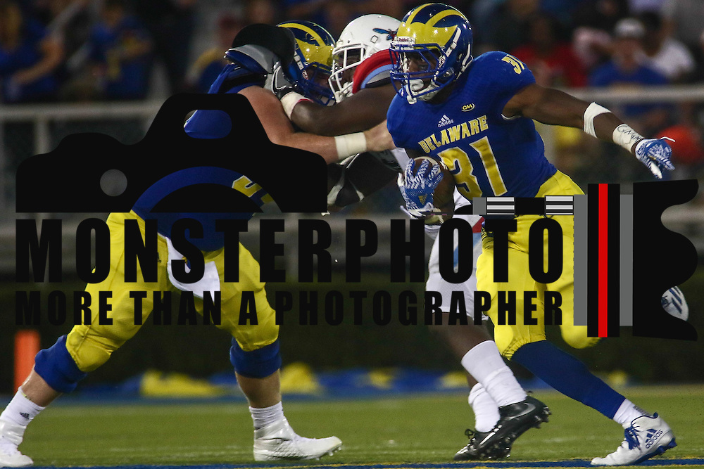 Delaware Running Back WES HILLS (31) runs into the open field during a week one game between the Delaware Blue Hens and the Delaware State Hornets, Thursday, Sept. 01, 2016 at Tubby Raymond Field at Delaware Stadium in Newark, DE.