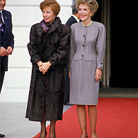 Raisa Gorbachev and Nancy Reagan stop for photographers at the south entrance to the White House. .Wrinkled stockings on Mrs. Gorbachev highlighted in Bunte magazine.