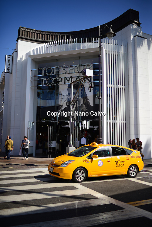 Yellow cab and Topshop store at The Grove, Los Angeles.