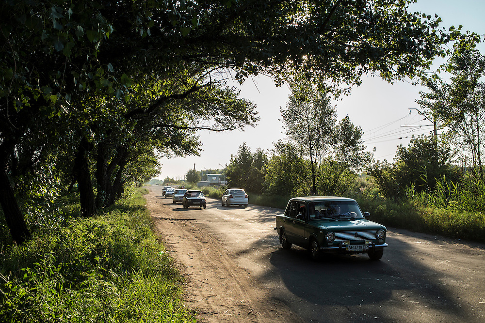 Cars drive away from the city of Horlivka, the scene of intense fighting, on Sunday, July 27, 2014 in Makiivka, Ukraine.