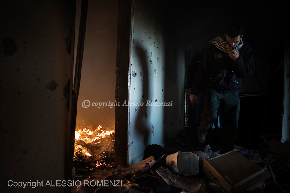 SYRIA - Al Qsair. A Syrian man walks inside the former police station in Al Qsair, on February 10, 2012. After a one day battle the Free Syrian Army manage to take control of the building. In the battle, 11 member of the Syrian police have been killed. ALESSIO ROMENZI