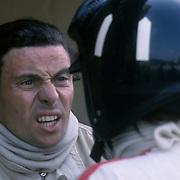Formula One (Grand Prix) driversGraham Hill (twice world champion) and Jim Clark (twice world champion), drivers for Team Lotus (Spa-Francorchamps, 1967).