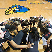 Northeastern Players huddle together prior to the start of an NCAA college basketball game between #9Delaware and Northeastern Sunday, Feb. 26, 2012 at the Bob Carpenter Center in Newark, Del.