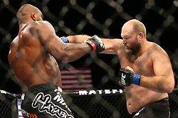 Ledyard, Connecticut, USA - September 5, 2014: Alistair Overeem (red gloves) and Ben Rothwell (blue gloves) during their main card bout at UFC Fight Night at the Grand Theater at Foxwoods Resort Casino in Ledyard, Connecticut.  Ed Mulholland for ESPN