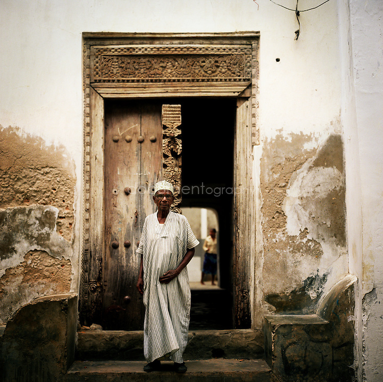 A man in front of his home in Stone Town, Zanzibar, Tanzania.