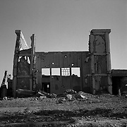 A view of the main building at Tarnak Farms, the al Qaeda base, training camp and pre 9/11 al Qaeda headquarters in Kandahar, Afghanistan which served as a home to Osama Bin Laden and numerous al Qaeda fighters located outside Kandahar City. It is believed that this base was where the plan for the 9/11 attacks originated, as a result Tarnak Farms was heavily bombed by the United States after September 11, 2001. (Credit Image: © Louie Palu/ZUMA Press)