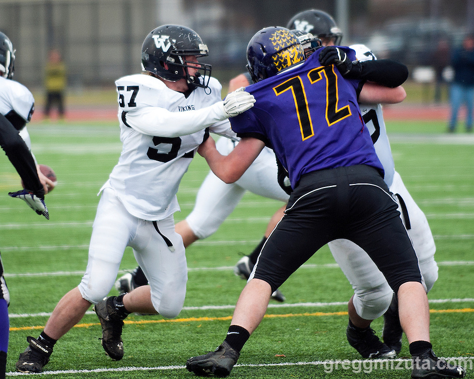 Vale's Andrew Collins and Kye Yraguen double team Harrisburg's Jay Parks in the first quarter of the Oregon 3A State Championship. Kennison Field, Hermiston, Oregon,  November 29, 2014.  Vale defeated Harrisburg 45-19 to win the 3A State Championship and finish with a 12-0 season record.