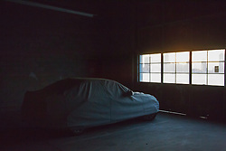 covered car in an indoor garage in New York City
