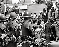 Students face riffles and bayonets at Campus memorial service for James Rector who had be shot days earlier after Governor Reagan sent US National guard in to battle protesters over People's Park at University of California in Berkeley 1969