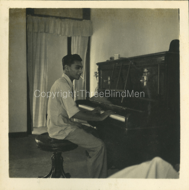 The piano player is Percy Weeraratne taken at my Uncles house 27 Elibank Rd which still exists more or less original. He was a commercial pilot but did not I think work for an airline but was at one time flying charters of fish&mdash;Batti to Colombo.<br />