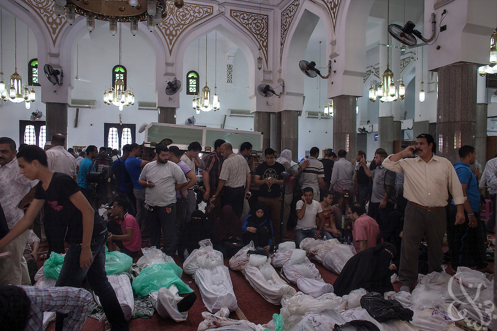 Egyptians come to try to identify their dead relatives at the Iman mosque August 15, 2014 in the Nasr City district of Cairo, Egypt.  A day after a violent raid by security forces on the supporters of deposed Egyptian President Mohamed Morsi, the country is trying to come to terms with the news that at least 600 people were killed and thousands more injured across Egypt during the raid on Rabaah al-Adawiya, and another, smaller protest camp in the district of Giza across town.