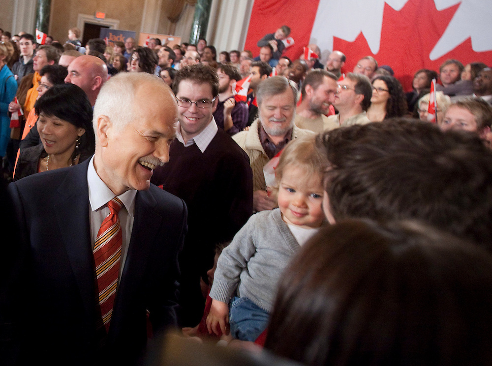 NDP leader Jack Layton laughs with his granddaughter at the NDP's campaign kickoff event at the Chateau Laurier in Ottawa, Ontario, March 26, 2011 following the fall of the Conservative government  Friday. Canadians will be heading to the polls May 2.<br /> AFP/GEOFF ROBINS/STR