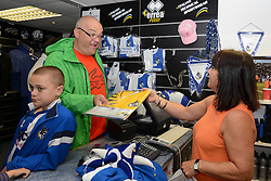 A Bristol Rovers fan buys a new Bristol Rovers replica shirt during an open day at the Memorial Stadium - Mandatory by-line: Dougie Allward/JMP - 07966386802 - 26/07/2015 - SPORT - FOOTBALL - Bristol,England - Memorial Stadium - Bristol Rovers Open Day - Bristol Rovers Open Day