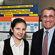 Tufts University President Anthony P. Monaco congratulates Medford High School student Erica Budina at the Region IV science fair hosted at Somerville High School on Saturday, March 24, 2012. Ms. Budina won a prize sponsored by Tufts University and advanced to the Massachusetts state finals at MIT. (Alonso Nichols/Tufts University)