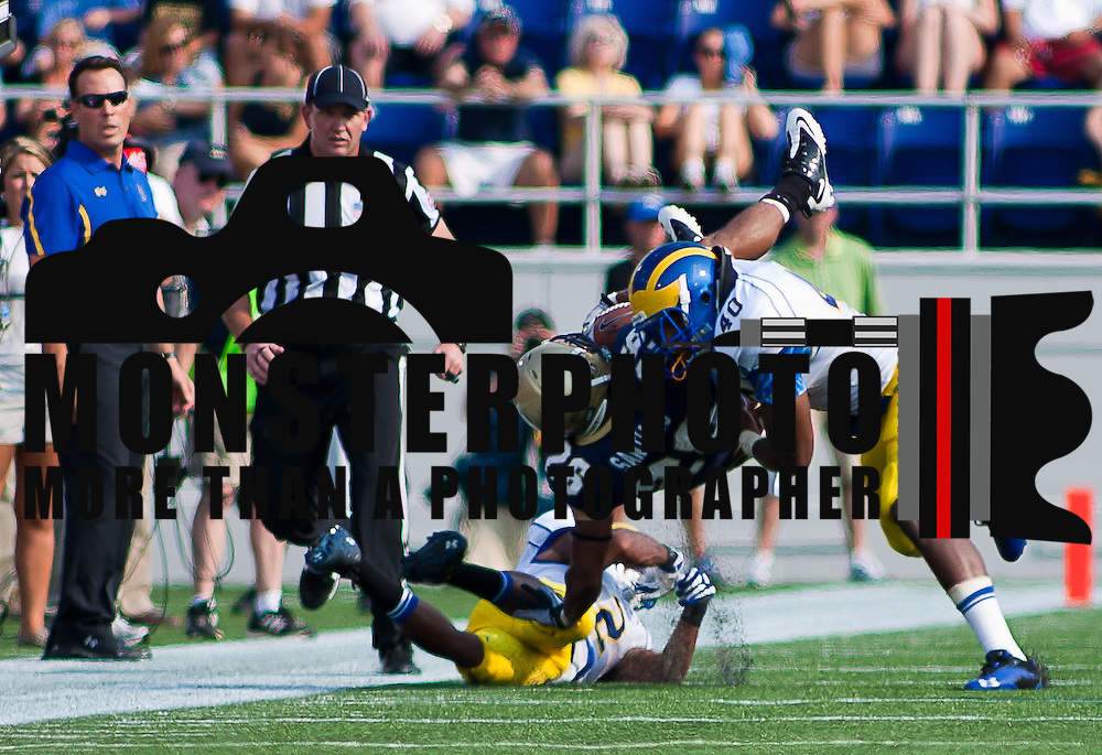 Navy Running Back Aaron Santiago #26 is upend by Delaware Linebacker Andrew Harrison #40 in the first quarter Saturday Sept. 3, 2011 at Marine Corps Memorial Stadium in Annapolis Maryland.<br /> <br /> Navy would go on to defeat Delaware 35-33 Navy leads the all-time series against the Blue Hens, 9-7, including a 35-18 victory in 2009 when quarterback Ricky Dobbs rushed for five touchdowns.<br /> <br /> Navy will hit road for a show down with Western Kentucky next Saturday Sept. 10, 2011 in Bowling Green, Ky.