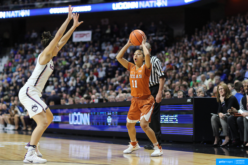 UNCASVILLE, CONNECTICUT- DECEMBER 4: Brooke McCarty #11 of the Texas Longhorns in action while defended by Kia Nurse #11 of the Connecticut Huskies during the UConn Huskies Vs Texas Longhorns, NCAA Women's Basketball game in the Jimmy V Classic on December 4th, 2016 at the Mohegan Sun Arena, Uncasville, Connecticut. (Photo by Tim Clayton/Corbis via Getty Images)
