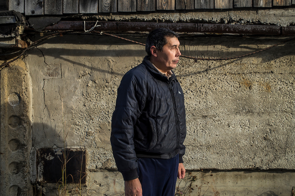 Vladimir Shikhanov, a former worker at the Baikalsk Pulp and Paper Mill who was recently laid off, poses for a portrait on Wednesday, October 23, 2013 in Baikalsk, Russia.