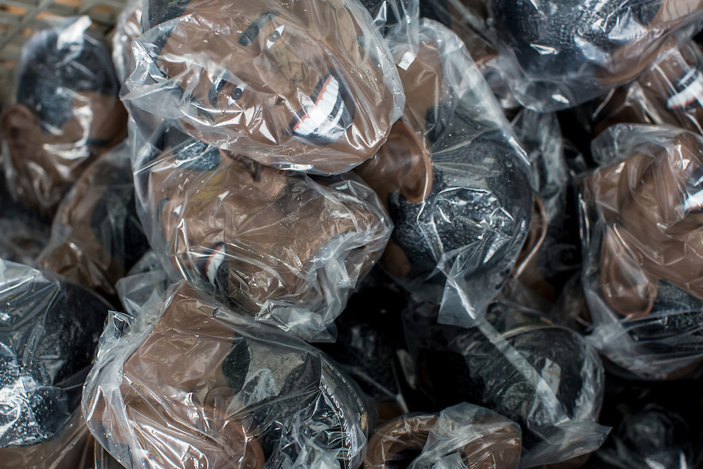 Barack Obama heads being given away are wrapped in plastic on Tuesday, September 4, 2012 in Charlotte, NC.